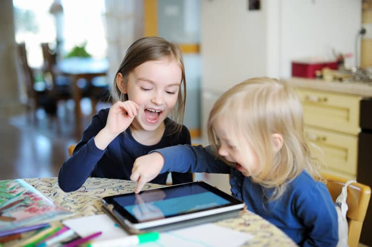 Kids playing on a tablet